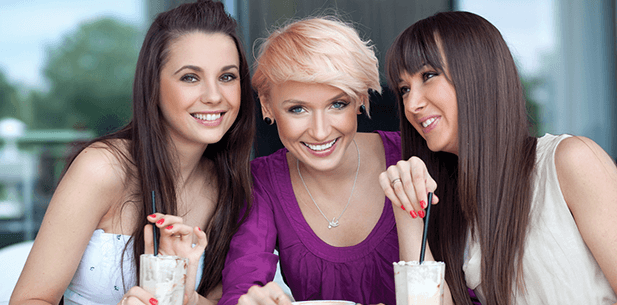 3 women smiling with white teeth