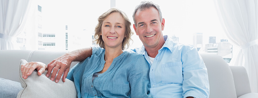 couple smiling with dentures