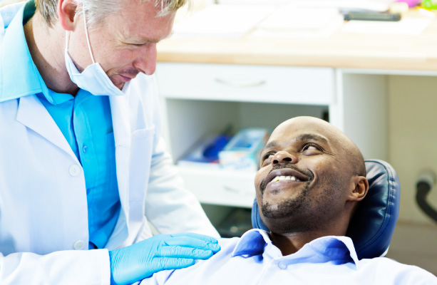 african american man in dental chair asking how sedation can help with dental anxiety