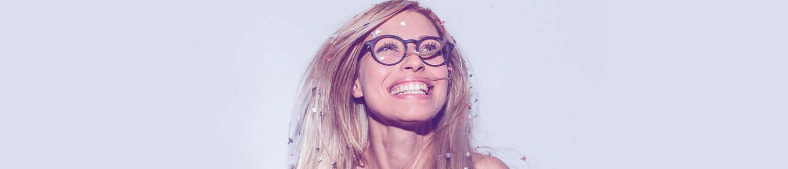 Woman with confetti smiling