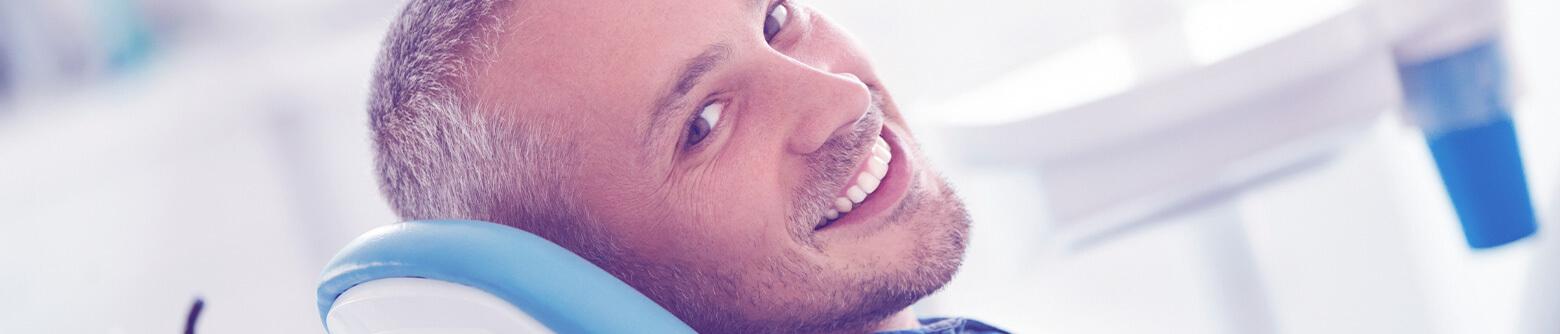 Man smiling in dental chair