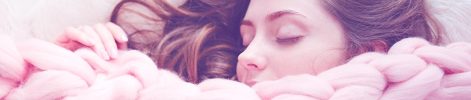 Woman snuggled in blanket