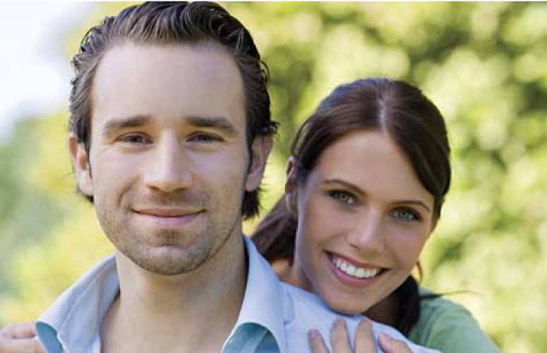 young couple smile after professional teeth whitening