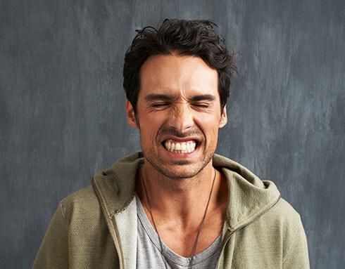 a man gritting his teeth