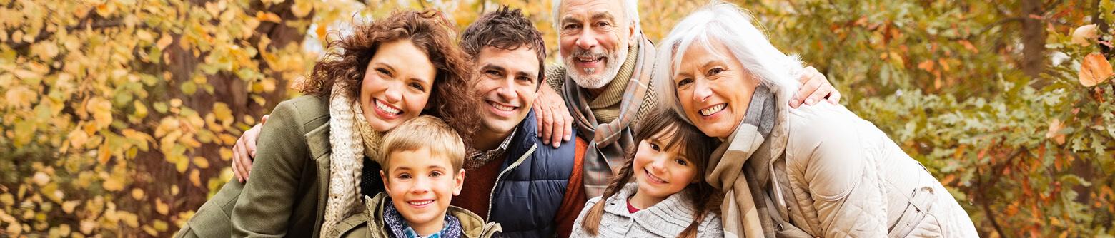 multigenerational family outside smiling together